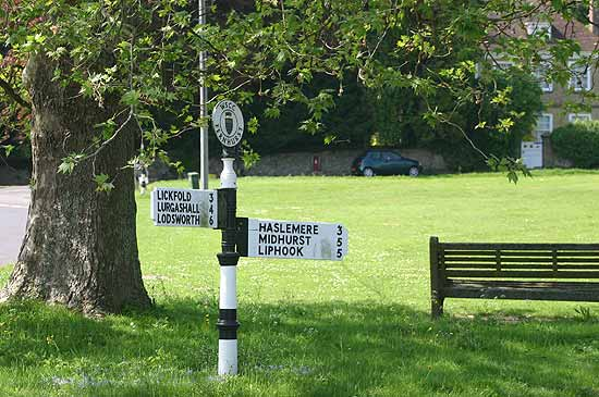 A traditional Sussex fingerpost at the recreation ground in Fernhurst village.