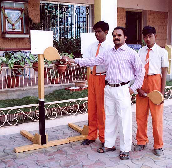 Sangram Gadgil with two students